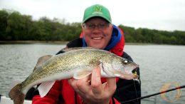Bill Bunn holding up a fresh walleye